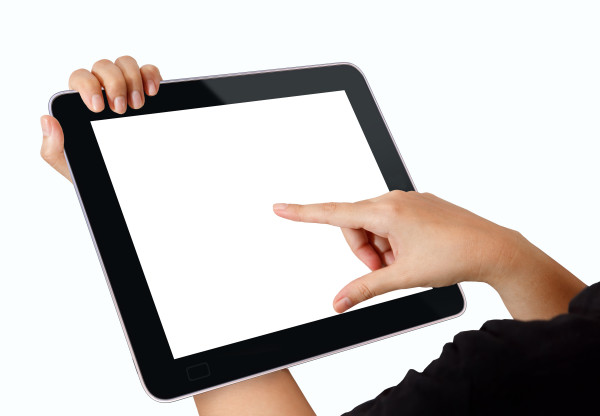 Female holds and touch tablet computer isolated on white background